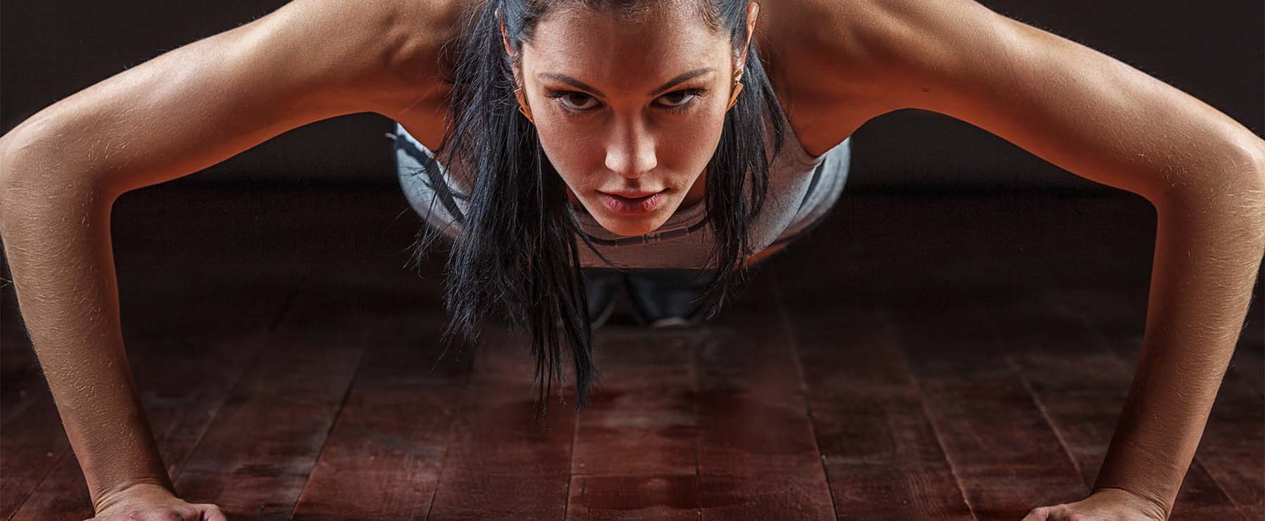 determined woman doing pushups